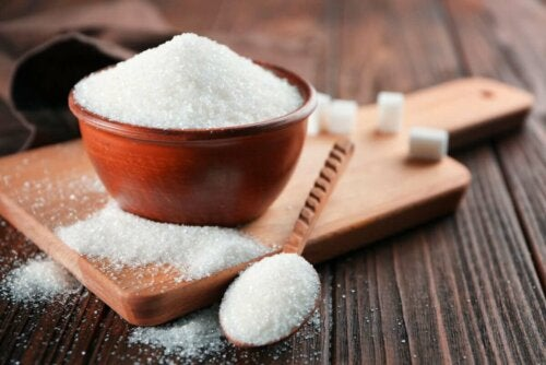 A bowl of sugar on a table.