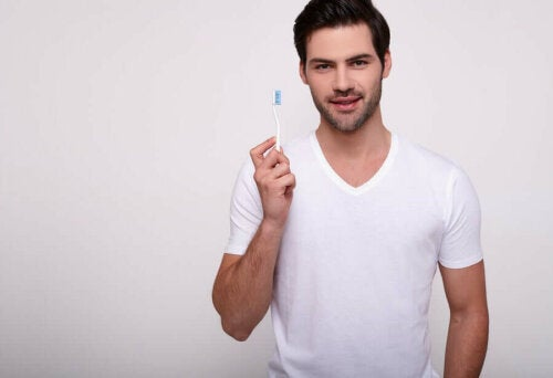 A man with a toothbrush.