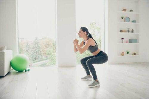 A woman squatting.