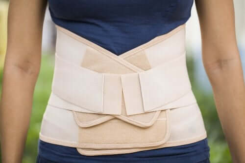 A woman with one of many types of waist trimmers.