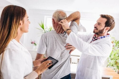 Doctors helping a man stretch.