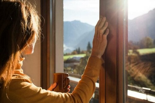 A woman looking out the window because she's alone.