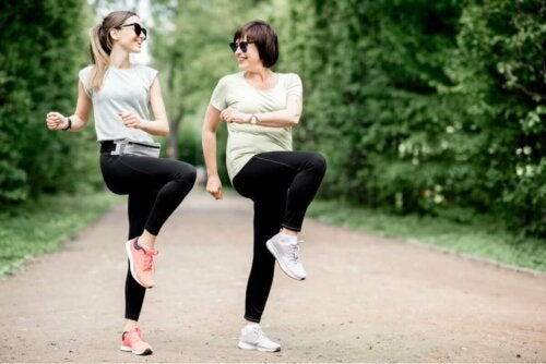 Two women dancing in order to get stronger feet.