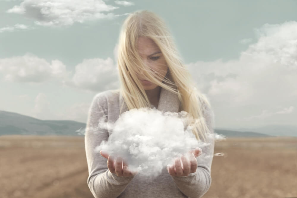 Woman looking at cloud in her hands