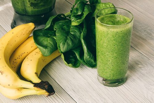 a green smoothie with leafy greens and bananas