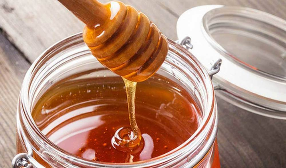 A glass jar of honey.