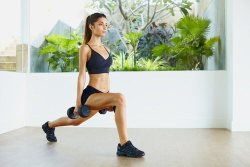 a woman doing lunges with weights