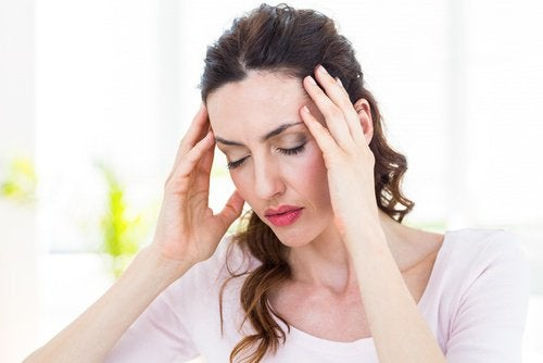 Woman with headache eyes closed
