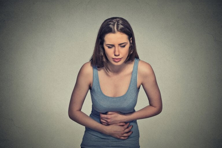 a woman experiencing the abdominal pain of endometriosis