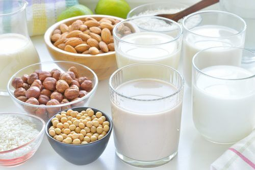 Some glasses of milk and nuts.