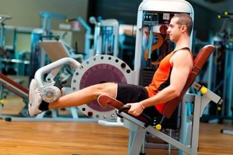 A man doing leg extensions.