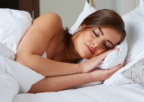 A woman sleeping peacefully in a bed
