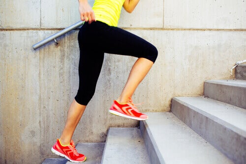 woman climbing stairs to combat being overweight