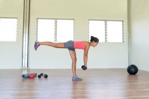 A woman doing leg exercises with weights.