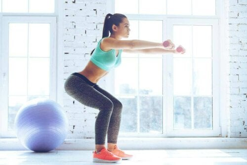 A woman doing some squats which are great for toning your legs.