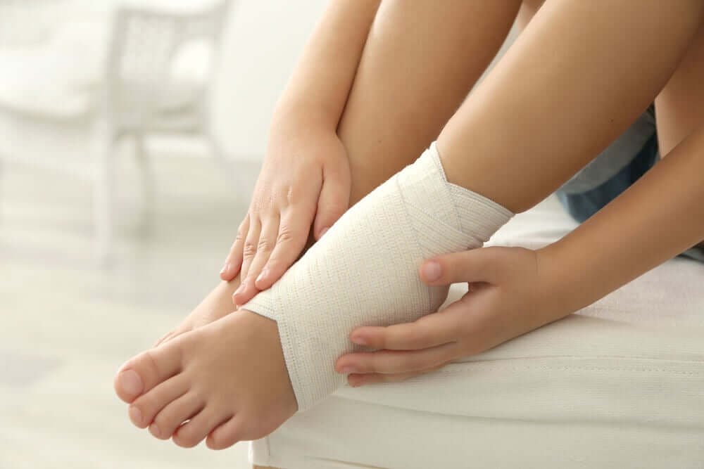 A woman with a bandage on her ankle.
