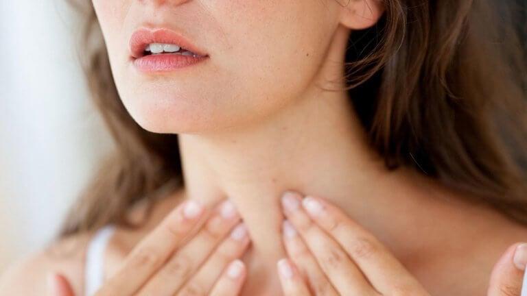 Woman touching her throat