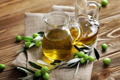 olive oil on a table in a jug; masks for healthy hair