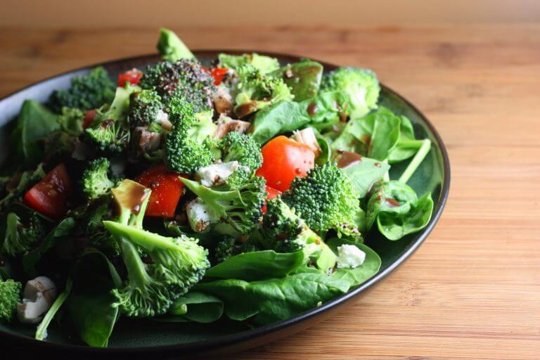 A green salad with broccoli and tomatoes.
