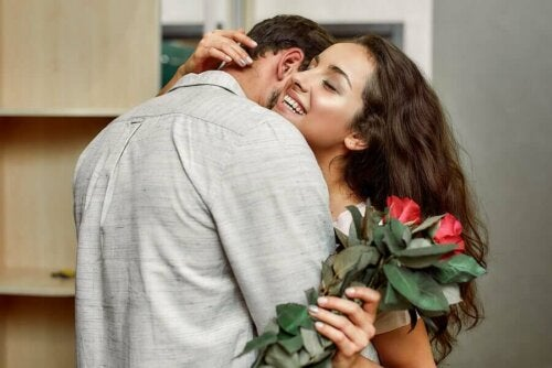woman and man embracing with flowers; seduce your partner