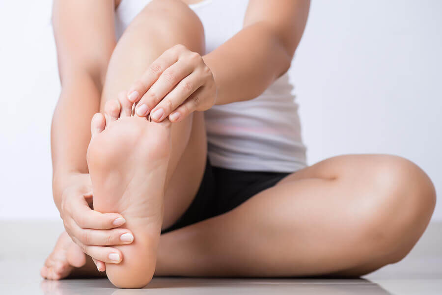 A woman stretching her foot.