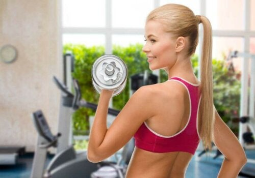 woman lifting weights; best chest exercises