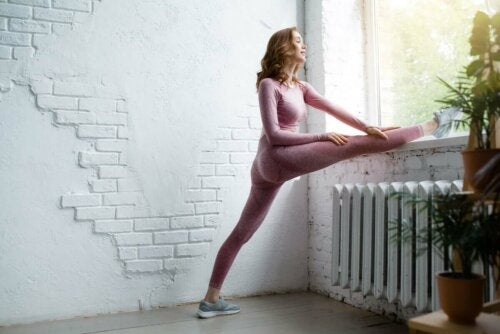 A woman with high energy levels stretching.