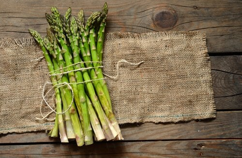 Some cut asparagus on a table.