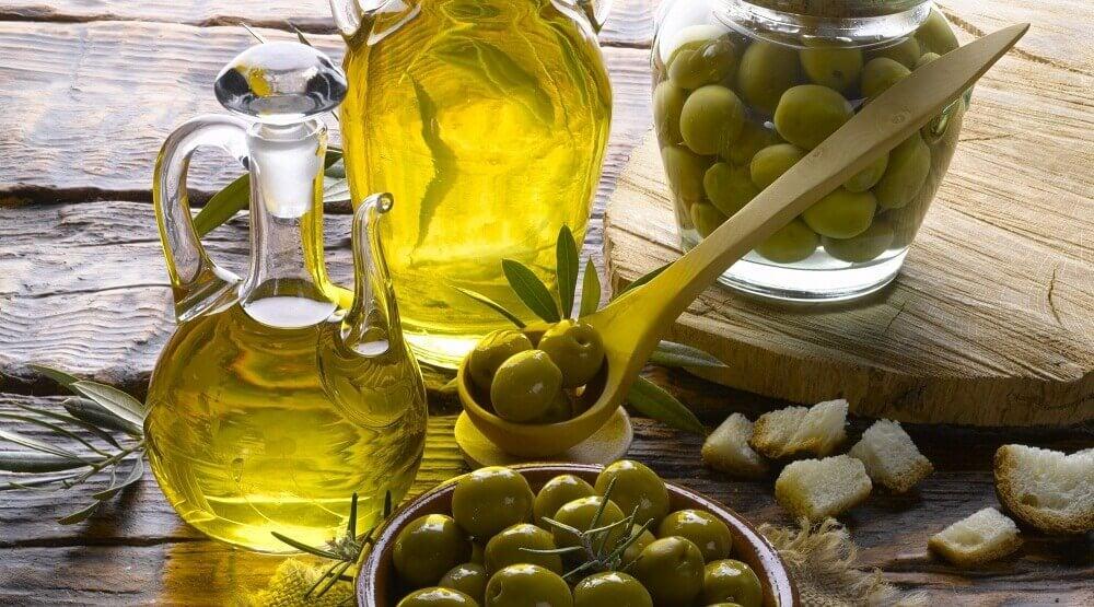 Some bottles of olives and olive oil for frying.