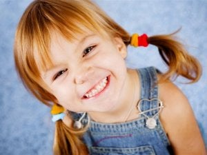 girl with pigtails smiling happily