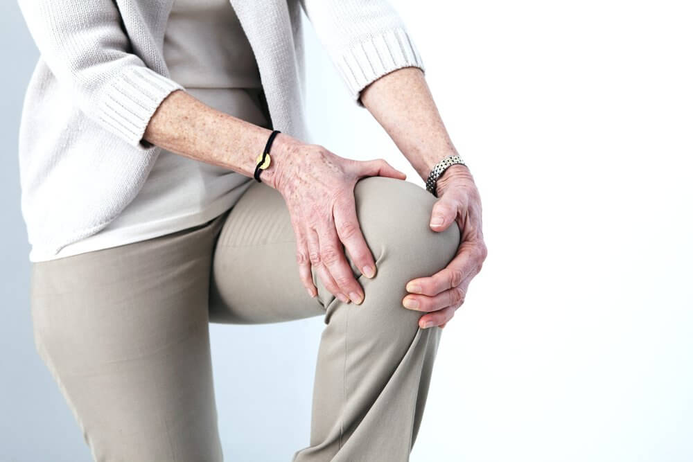 A woman with knee pain.