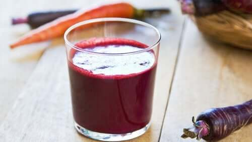 A glass of fresh beet and carrot juice.