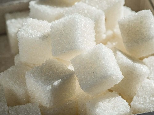 A close up photo of sugar cubes.