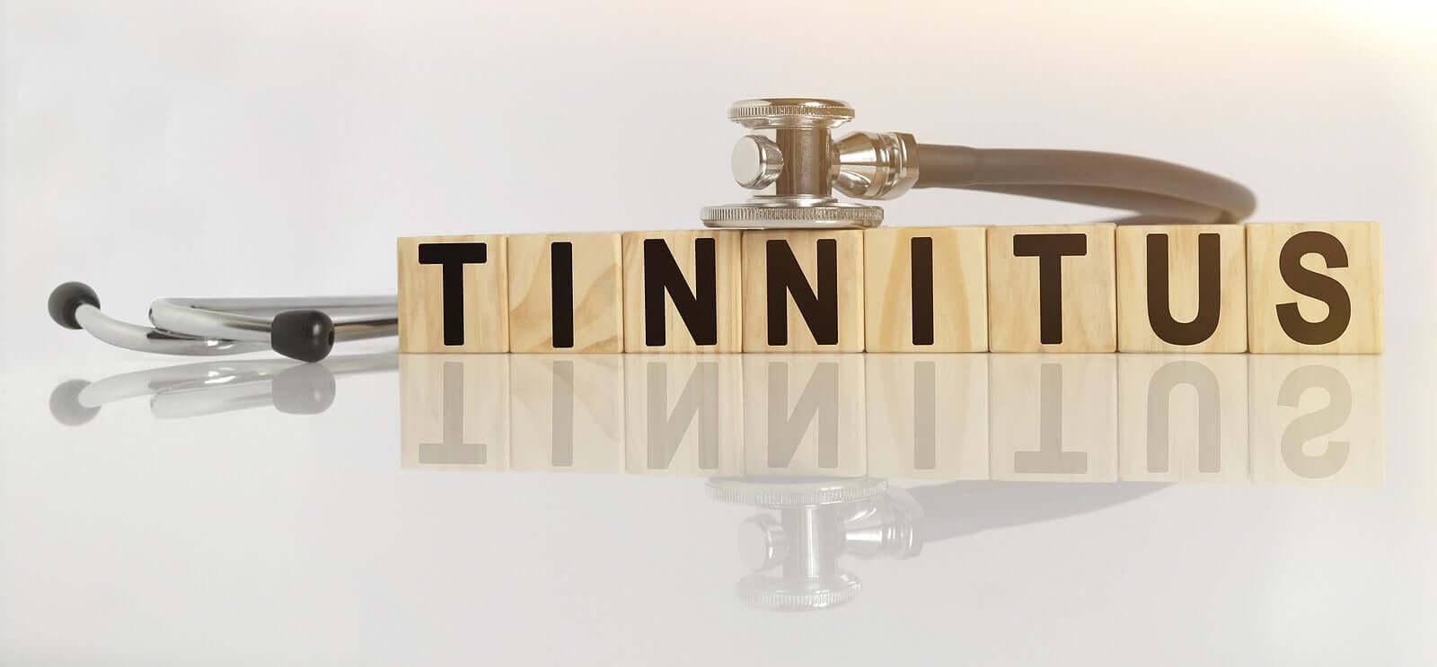 "Wooden blocks that read ""tinnitus""."
