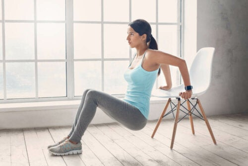 woman doing exercise with a chair; toned stomach in 3 weeks