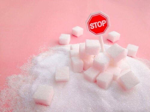 A pile of sugar with a stop sign.