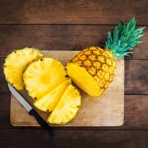 Some sliced pineapple on a cutting board.