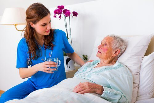 a senior citizen and a nurse in a hospital