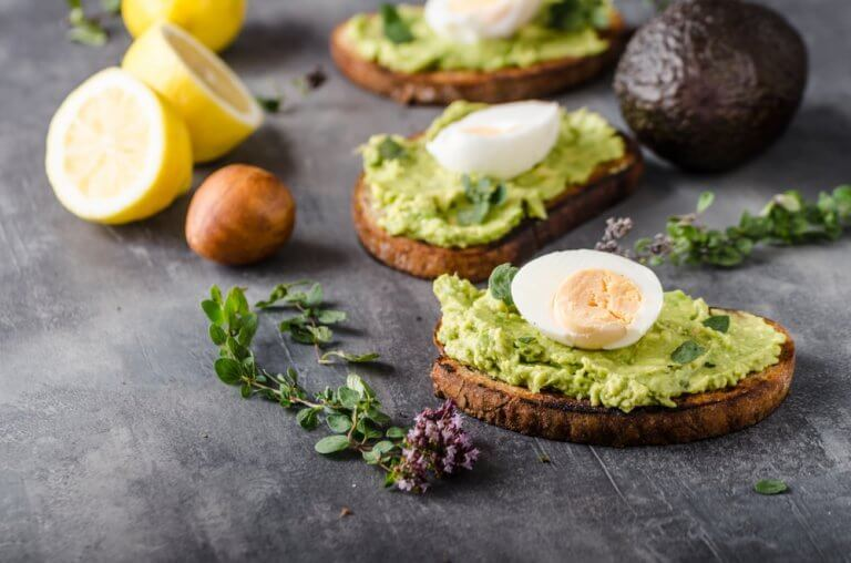 Avocado toast with eggs to add to a healthy diet.