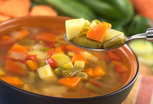 vegetable soup with potatoes, peas, and carrots.