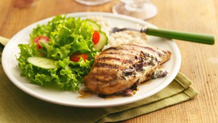 grilled chicken breast with a salad.