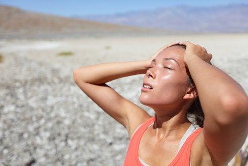 A girl enjoying the sun on the beach.
