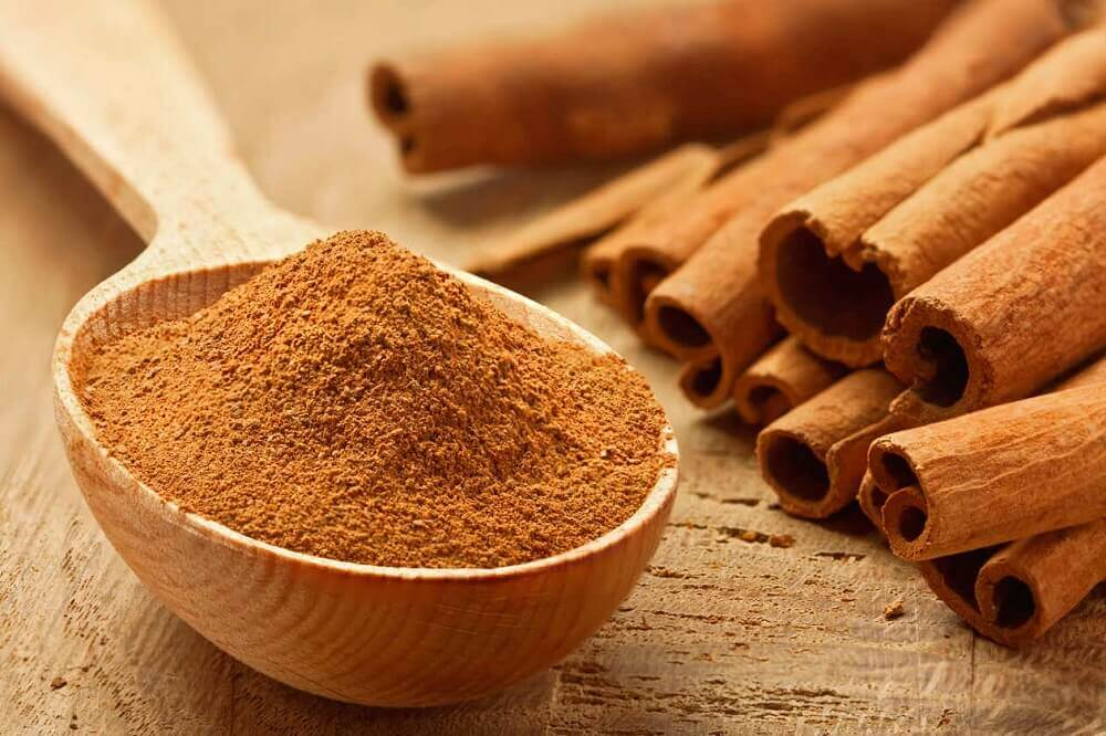 Cinnamon in a wooden spoon