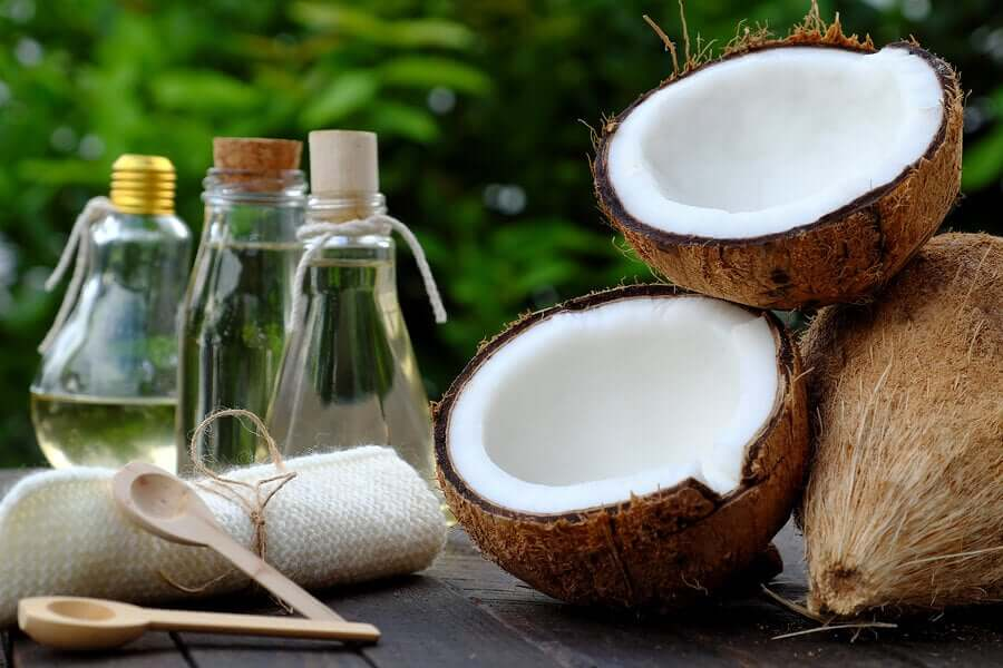 A fresh coconut and coconut oil.