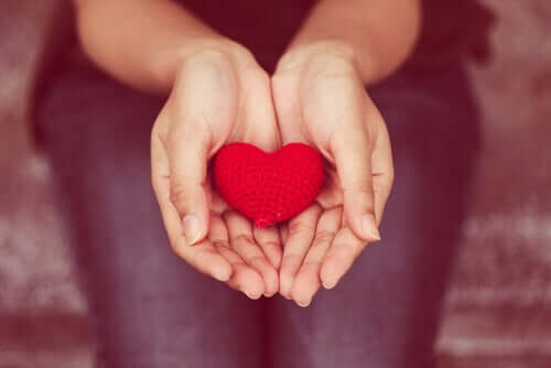 A woman's hands with a heart in them.