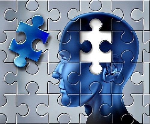 puzzle of a person with a piece missing by the brain, representing alzheimer's disease