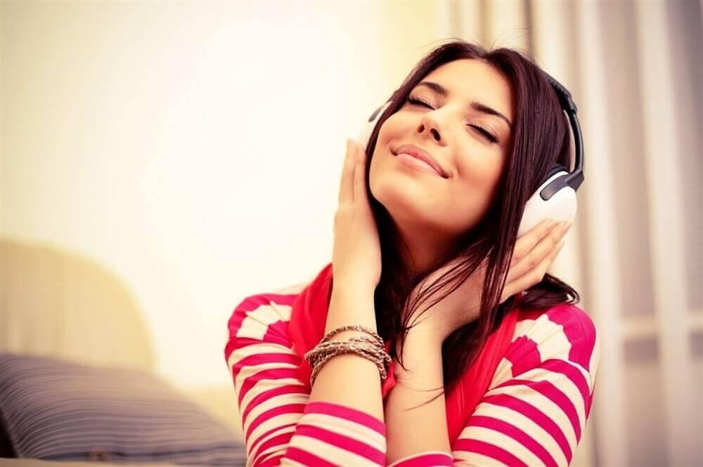 wman listening to music with headphones