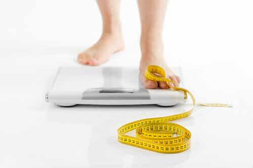 A foot on a weighing scale.