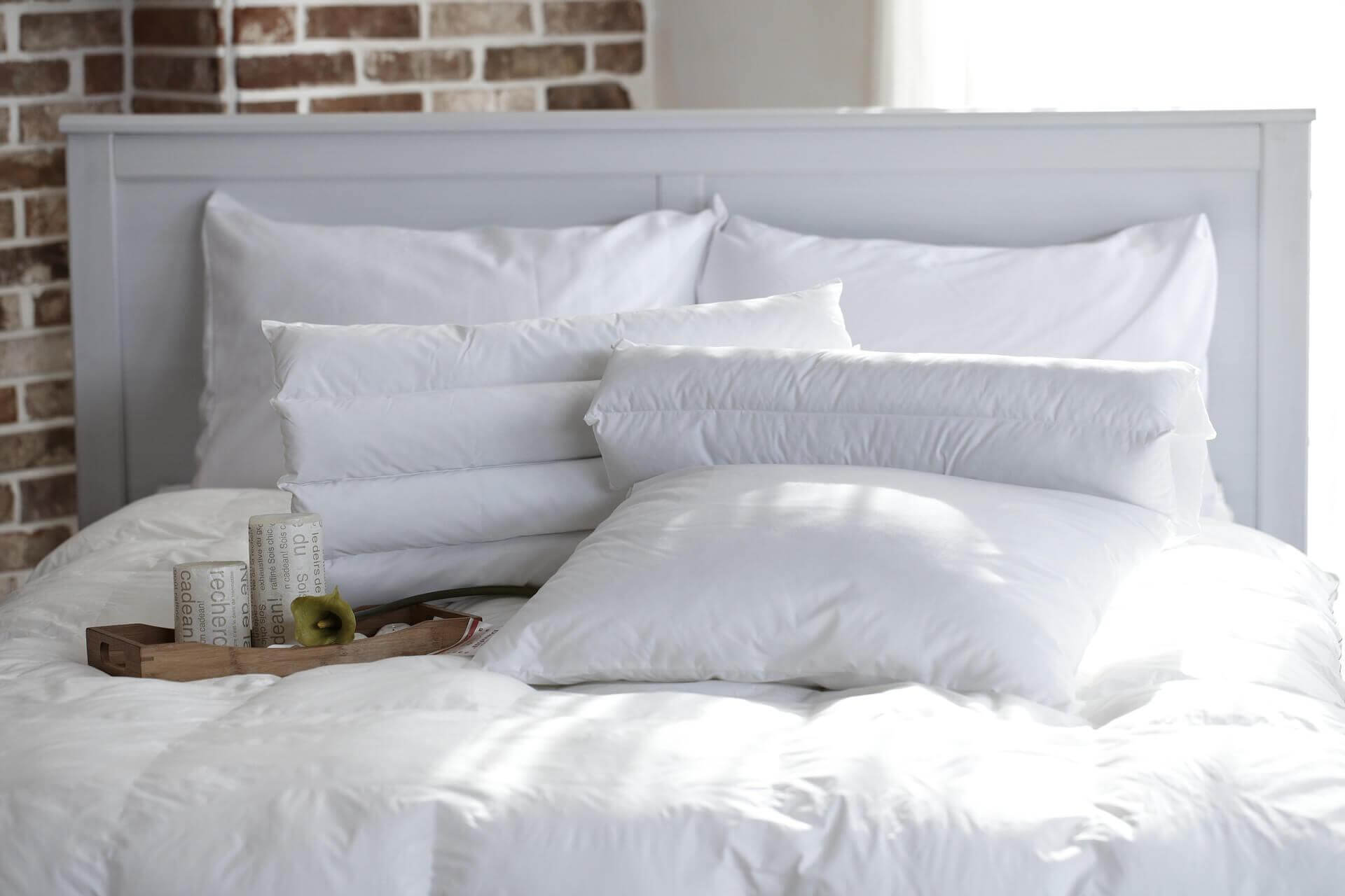 a lot of pillows on a big mattress: things that expire