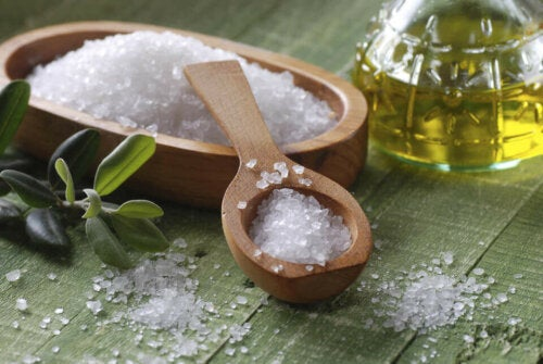 sea salt in a wooden pot with a wooden spoon